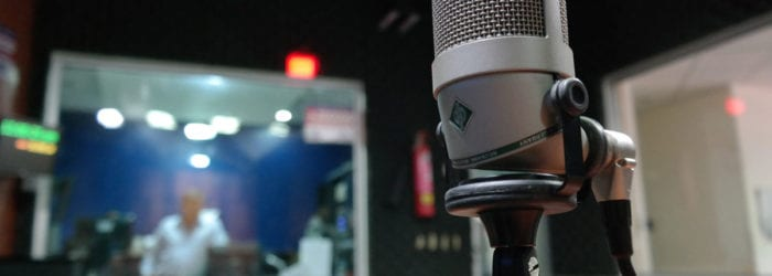 photo of a microphone in a recording studio